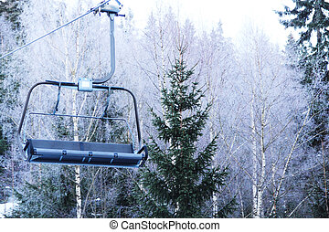 Ski lift on winter forest background close-up