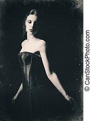 Dramatic retro portrait of beautiful sad gothic girl among...
