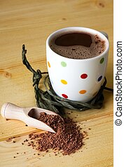 Hot chocolate and brown powder on light table - Horizontal...