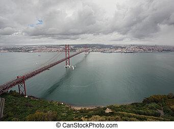 The 25 de Abril Bridge in Lissabon, Portugal - The 25 de...