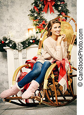 sweet home - Charming young woman celebrating Christmas at...