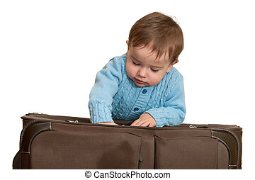 Last details before travelling starts - A toddler is packing...