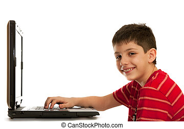 Kid is studying using the laptop - A boy is sitting at the...