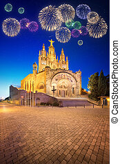 Beautiful fireworks under Tibidabo church on mountain in...