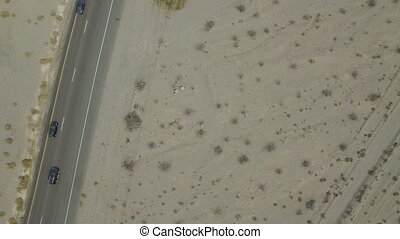 Cars driving on desert road - Birdseye view of cars driving...