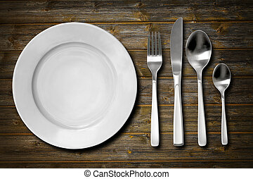 Cutlery set with fork, knife, spoon and plate. Overhead...
