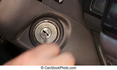 Trying plugging the car keys - close up Trying plugging the...