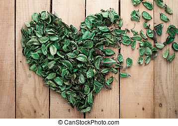 nature fade - heart made of leaves fading away on wooden...