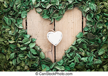 nature in love - white wooden heart in the heart which made...