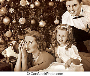 Family with children dressing Christmas tree. - Family with...
