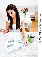 Young business woman working from home