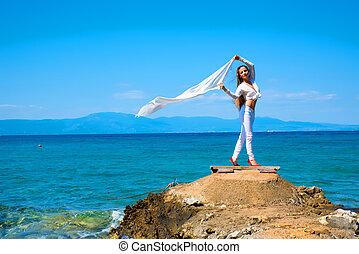 Beautiful young woman enjoying the ocean - A beautiful young...