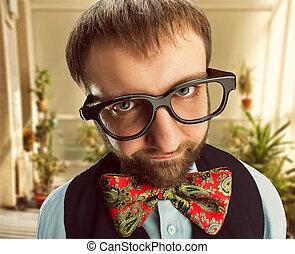 Strange nerd in glasses looks at you
