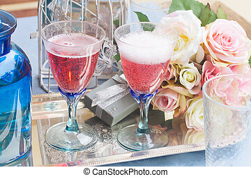 Twoo glasses of pink champagne - Two glasses of pink...