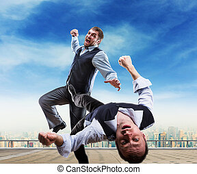 Businessmen fighting - Two businessmen fighting on the roof