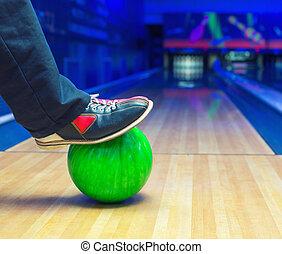 Strike on a bowling ball - Preparing to strike on a bowling...