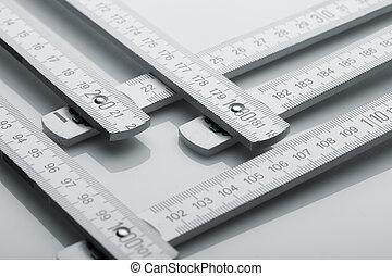Metre measure ruler - Metal metre measure ruler over white