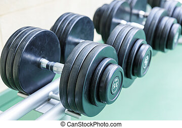 Set of dumb-bells - Dumb-bells on the stand in the gym...