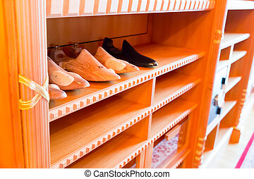 Wooden stands for shoes - Shelves with wooden stands for...