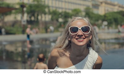 Happy girl in sunglasses walking on the French Riviera in...