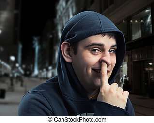 young man with finger in his nose