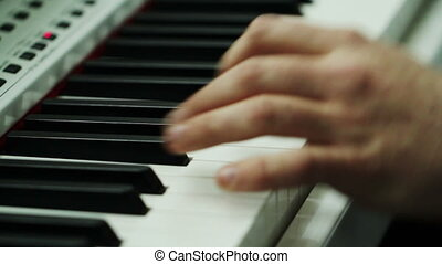 Mans Hands Play Synthesizer - Mans hands play piano at...