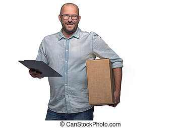 Smiling male courier delivering a parcel - Smiling...