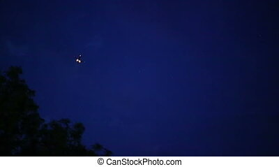 Plane at Dark Sky - Flying plane with headlights an night...
