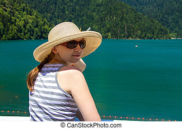 Happy young woman with panama hat