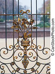 Metal wrought-iron gates with floral patterns