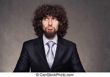 business think - confused young businessman trying to make a...