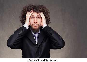 business problem - facial expression of a young businessman...
