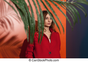 red voyeur - beautiful elegant young woman wearing red...
