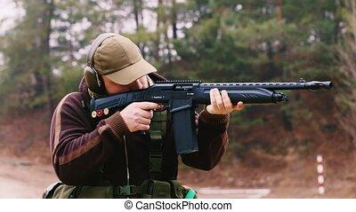 Man shooting a shotgun