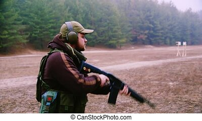 Military training in shooting, shooting at targets on the...