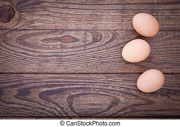 eggs on wooden background top view