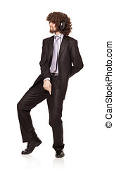 dancing business - afro style haired young businessman...