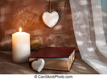 grunge romance - romantic concept with candle,wooden hearts...