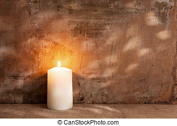 candle - single candle light on grunge background.still life...