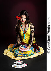 Gypsy woman tell fortunes by cards