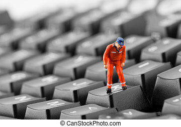 Worker looking into pit in keyboard