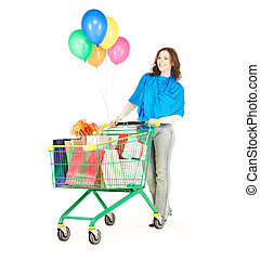 holiday shopper - happy woman with shopping cart and...