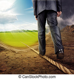 Businessman walking on tightrope on the nature