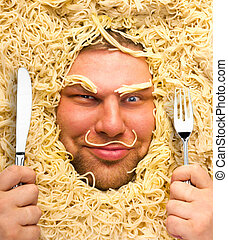 Man in pasta - Funny man with fork and knife in pasta