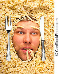 Man's face in pasta, closeup - Man lying in pasta, dinner...