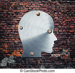 Metal silhouette of human head on the wall