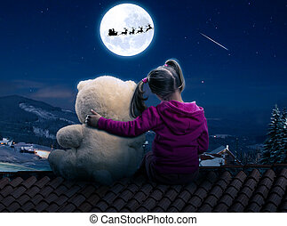 Small cute girl sitting on the roof with toy bear - Little,...