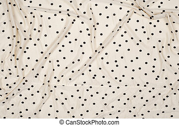 fabric of beige polka dots