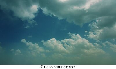 Slow Moving Clouds with Birds Flying