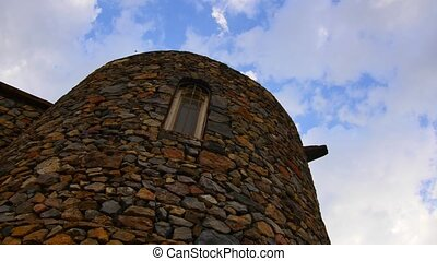 Old Stone Tower with Clouds and Birds